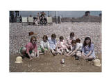 Group of Children Sit, Playing in the Sand at Dymchurch Beach Photographic Print by Clifton R. Adams