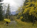 Kayaker En Route to the Kananaskis River in Kananskis Provincial Park Photographic Print by Gordon Wiltsie
