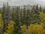 Early Snow Dusts Fall Colored Trees Surrounding a Hotel Photographic Print by Gordon Wiltsie
