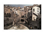 Shrunken Stream Meanders Through Dilapidated Houses in San Remo Photographic Print by Hans Hildenbrand