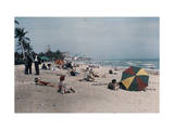 Group of People on Miami Beach Sunbathe and Look Out on the Ocean Photographic Print by Clifton R. Adams