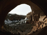 Anasazi Dwellings in a Sandstone Cliff and View of Snowy Landscape Fotografisk tryk af Paul Chesley