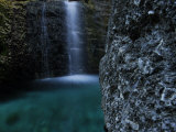 Waterfall and Boulders in an Aquarium Photographic Print by Raul Touzon