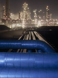 Night View of the Lights of an Oil Refinery Photographic Print by Michael Melford
