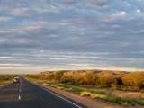 Car Driving Through Macdonnell Ranges in Northern Territory at Sunset Photographic Print by Brooke Whatnall