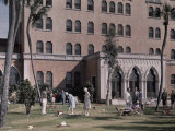 "Guests Play ""Obstacle Golf"" on the Lawn of a Davis Island Hotel Photographic Print by Clifton R. Adams"