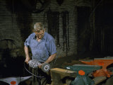Man Uses a Grinding Disk to Finish the Production of Anvils Photographic Print by Jack Fletcher