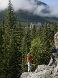 Rock Climber Starts a Rappel on a Crag Near the Banff Springs Hotel Photographic Print by Gordon Wiltsie