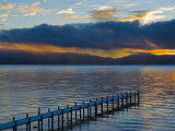 Snow Covered Pier on Lake Tahoe with Dramatic Sunrise Light Photographic Print by James Forte