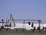Sailboat and Kids on a Swing at a Playground at Sept-Iles, Quebec Photographic Print by Michael Melford