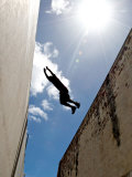 Parkour Practitioner Jumps a Building Gap in Adelaide, Sa Photographic Print by Brooke Whatnall