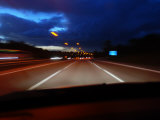 Blurred Motion of Cars Traveling Down a Highway at Dusk Photographic Print by Mattias Klum