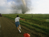 Storm Chaser Plants a Weather Probe in the Path of a Tornado Photographic Print by Peter Carsten