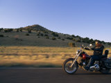 Motorcycle Rider Cruises Back Roads Near Cerrillos Photographic Print by Gordon Wiltsie