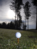 Golf Ball on a Tee at Twilight Fotografiskt tryck av Raul Touzon