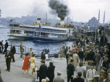 People Bustle Along Dock Near Steamers Emitting Smoke Photographic Print by Maynard Owen Williams