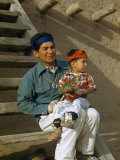 Native American Father and Son Dressed for a Dance Sit Together Photographic Print by Justin Locke