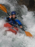 Young Kayaker Paddles in Waves on the Kananskis River, Near Calgary Photographic Print by Gordon Wiltsie