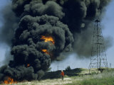 Burning Waste from an Oil Well Produces a Plume of Flames and Smoke Photographic Print by Jack Fletcher