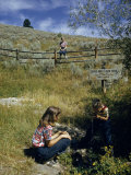 Children Taste Spring Water at Headwater of Missouri River Photographic Print by Ralph Gray