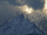 Snow-Blanketed and Cloud-Shrouded Peaks of the Rocky Mountains Fotografisk tryk af Paul Chesley