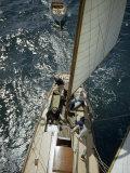 Sailors Sit in Sun on Deck of Sailboat Underway in a Good Breeze Photographic Print by Luis Marden