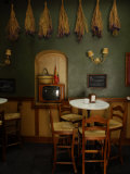 Tables and Chairs Inside a Tapas Restaurant Fotografisk tryk af Raul Touzon