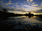 Nose of a Boat Cuts Through the Water on a Trip Down the Toro Morto River, in Brazil Photographic Print by Steve Winter