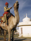 Man Riding Camel Prepares for Procession During Religious Festival Photographic Print by Volkmar K. Wentzel