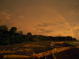 Rainbow Appears at Sunset at the Mouth of the Sierna River Photographic Print by Steve Winter