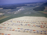 Colorful Airplanes are Parked in Rows at a Regional Airstrip Photographic Print by Jack Fletcher