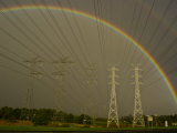 Vast Array of Electrical Towers and Cables Beneath a Huge Rainbow Photographic Print by Jason Edwards