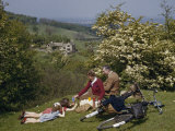 Cycling Family Picnics on a Rural Hillside in the Cotswolds Photographic Print by B. Anthony Stewart