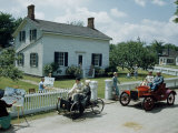 People in Costume Park Antique Ford Cars Near Henry Ford's Birthplace Photographic Print by Andrew Brown
