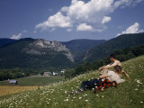 Men in Flower-Carpeted Hillside Meadow Look Toward Seneca Rocks Photographie par Walter Meayers Edwards