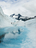 Tourist Trek Past Glacial Meltwater Pond on Mendenhall Glacier Photographic Print by James Forte
