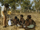 Aboriginal Women Watch a Nutritionist Weigh Fruit They Have Gathered Photographic Print by Howell Walker