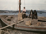Woman and Two Men Sit on a Boat Used to Move Goods to Chiloe Photographic Print by Jacob Gayer