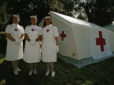 Nurses Stand Ready to Lend Aid at a Horse Jumping Event in Rome Fotografisk tryk af Paul Chesley