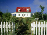 Cozy Cottage with a Red Roof and White Picket Fence Photographic Print by Michael Melford