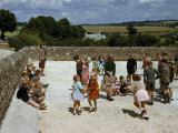 Teachers Watch Children Play During Recess in a Courtyard Photographic Print by Melville Grosvenor