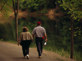 Couple Walking by the Water Along a Park Road Photographic Print by Raymond Gehman