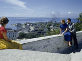 Tourists Survey Mackinac Island City from Fort Mackinac Photographic Print by Andrew Brown