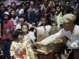 Vendor Offers Cotton Candy to Girl in Kimono, Nearby Crowd Watches Photographic Print by Joseph Baylor Roberts