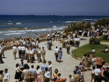 Pedestrians Fill a Seaside Park on a Sunny Sabbath Day Photographic Print by Maynard Owen Williams