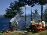 People Grill Food and Picnic on Hillside Overlooking a Lake Photographic Print