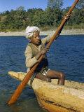 Ferryman Poles His Dugout Canoe across a River Photographic Print by Volkmar K. Wentzel