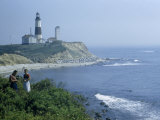 People Stand on Point across Bay from Montauk Point Light Photographic Print by B. Anthony Stewart