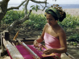 Woman Sitting under a Frangipani Tree Weaves at a Loom Photographic Print by W. Robert Moore