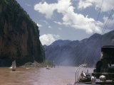 Sailing Junks and River Steamer Travel Past Steep Cliffs Photographic Print by W. Robert Moore